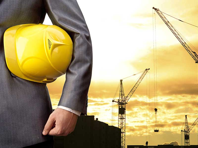 Structural engineer standing at construction site