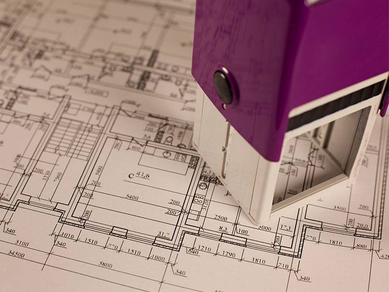 A building drawing is obatining an approval which is the first step of a construction project.