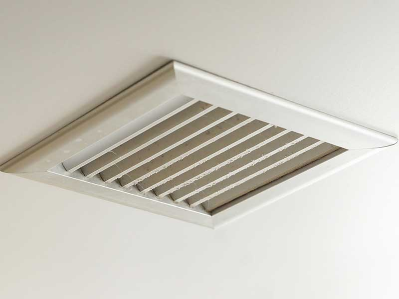 A square ducted vent on a ceiling